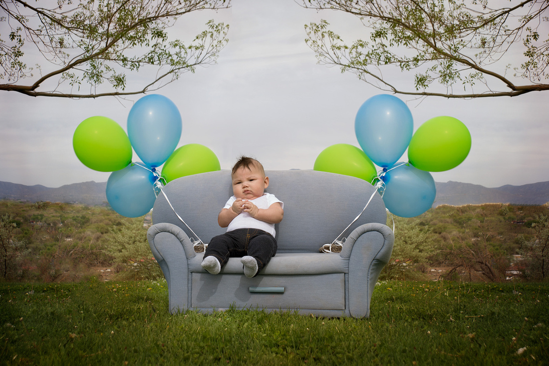 Richardson family portrait session at Alameda Open space in Albuquerque. These were balloon pictures of her boys. We had green and blue balloons and the Sandia mountains for decoration. For your own call 363-3266
